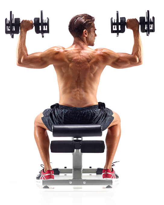 Man exercising with SelectTech Dumbbells