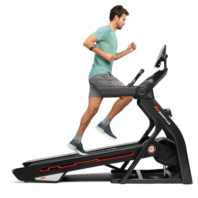 A man using the treadmill 10 in an incline position. - expanded view