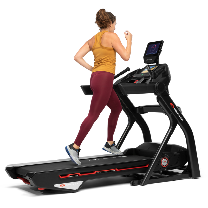 A woman jogging on a treadmill 10. - mobile expanded view