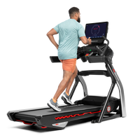Man using the touchscreen on the Treadmill 22--thumbnail