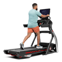 Man using the extended handlebars on the Treadmill 22--thumbnail