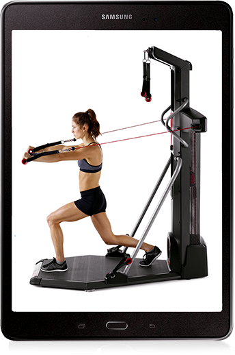 A tablet displaying a fit woman using the Bowflex HVT.