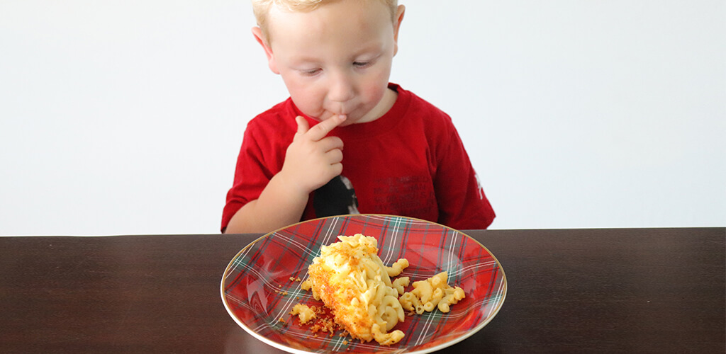 a child eating mac and cheese