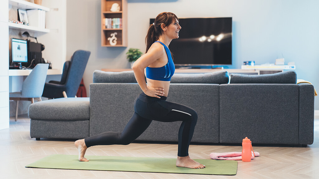 A woman performing a lunge.
