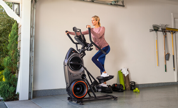 A fit woman using a Bowflex Max Trainer