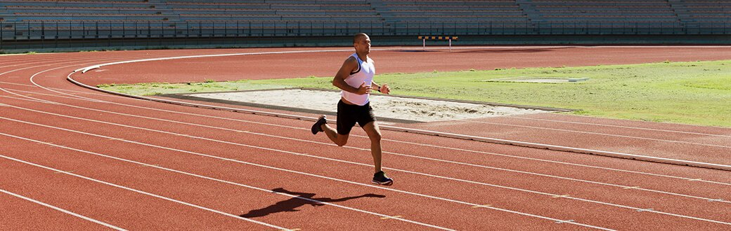 A man running on a track.