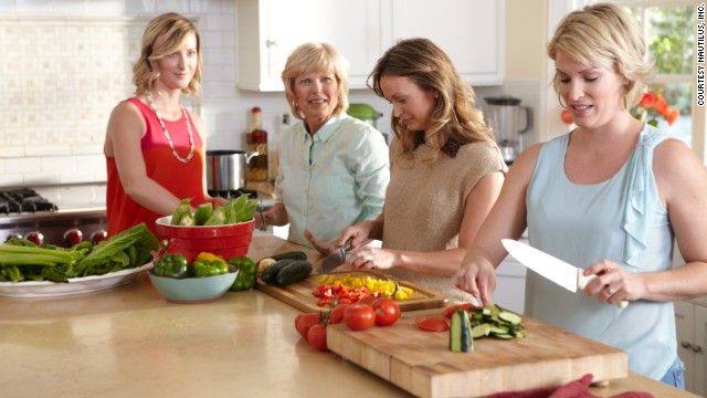 Colleen Whiteaker cooking with her three daughters