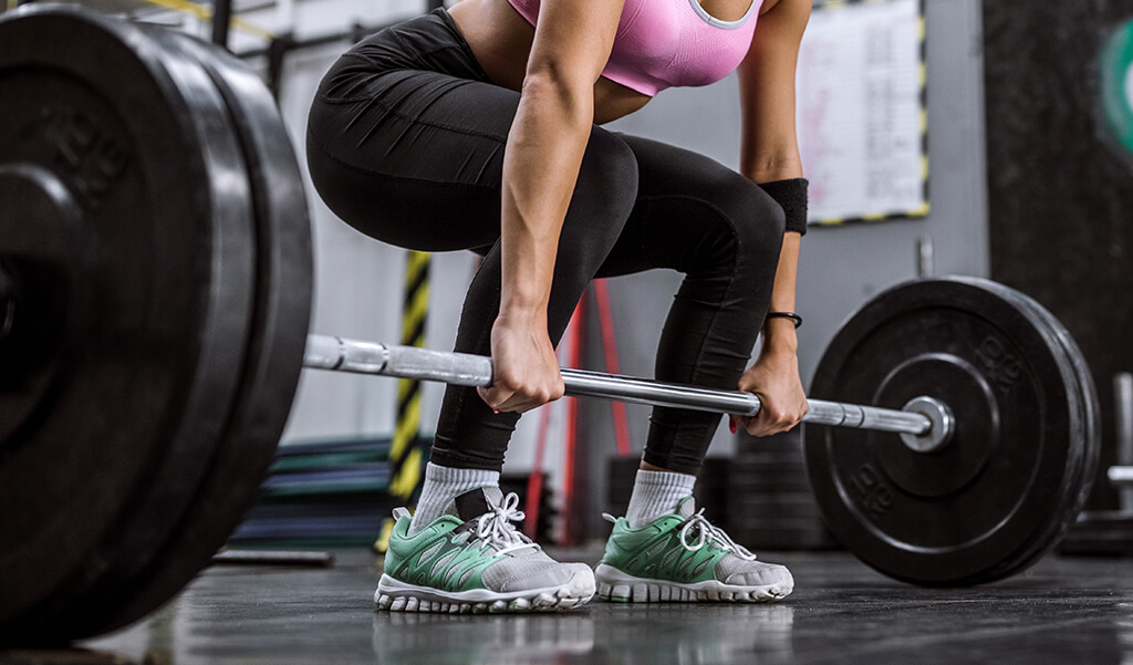 a woman deadlifting