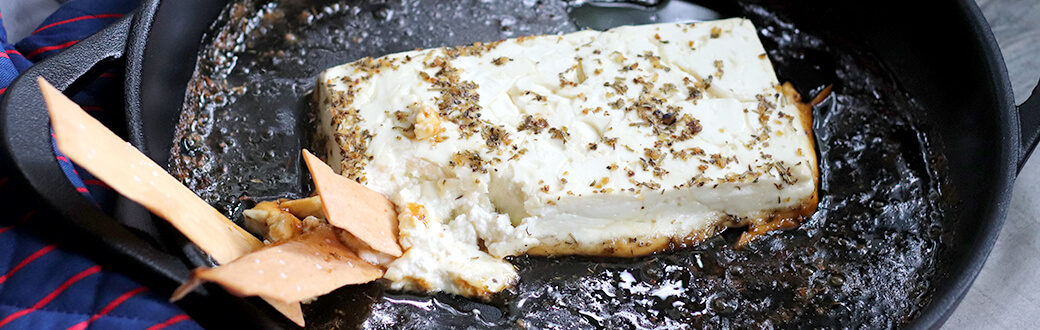 Agave and Herbs de Provence Baked Feta in a pan.