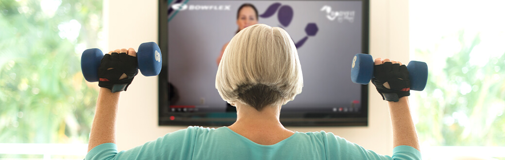 A woman using dumbbells