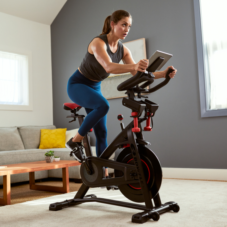 A woman working out on C6 Indoor Cycling Bike.