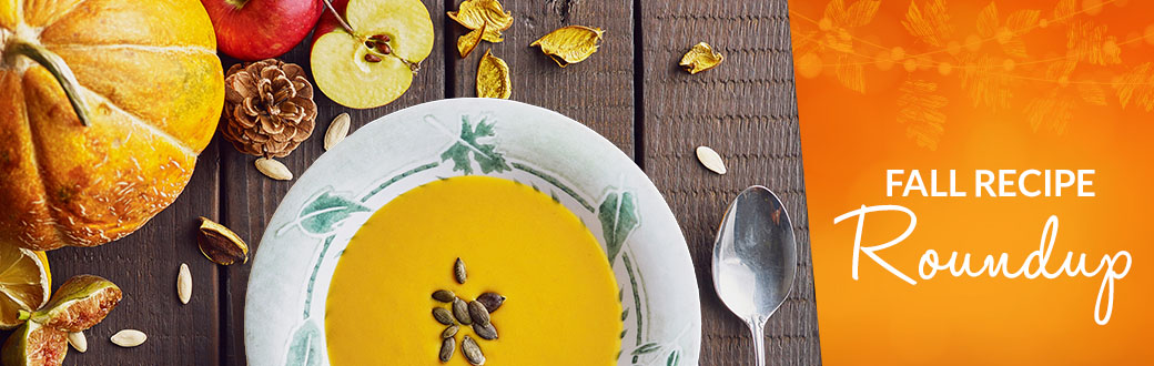 A bowl of pumpkin soup on a table.