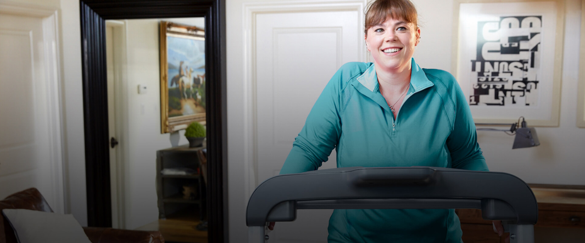 woman walking on a TreadClimber cardio machine