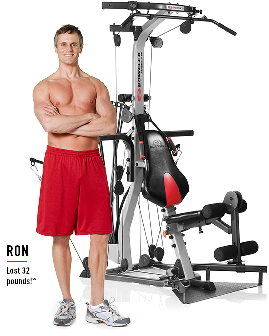 Ron lost 32 pounds.  Ron is standing next to a home gym.