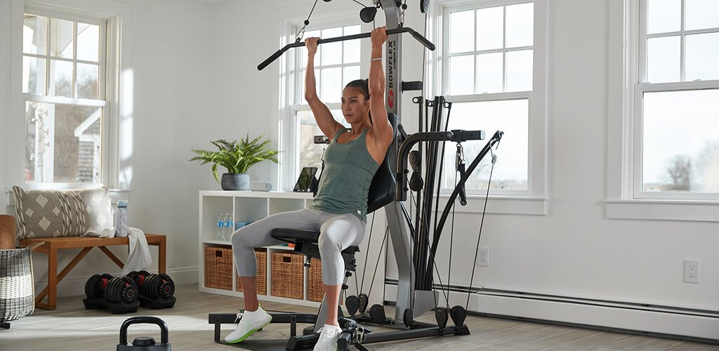 A woman working out on an X2SE Home Gym.