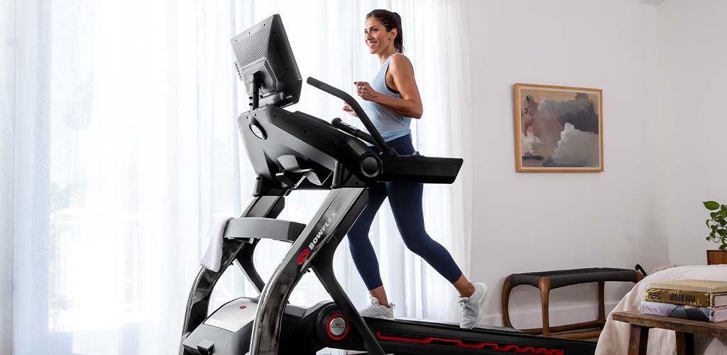 A woman running on a Bowflex Treadmill.