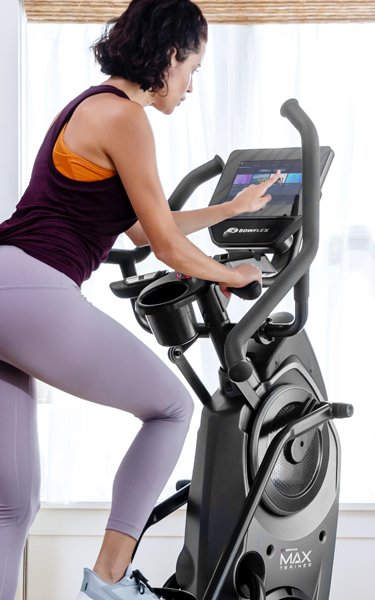 Woman using a Max Trainer