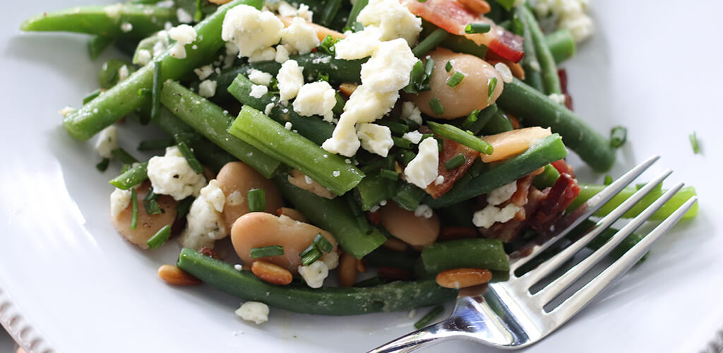 Blue and green bean salad in a serving dish.