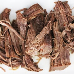 Shredded beef on a plate.