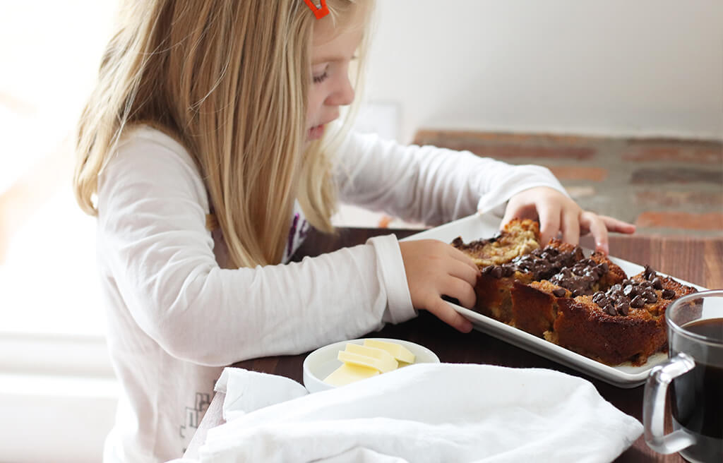 A child eating chocolate chip banana bread