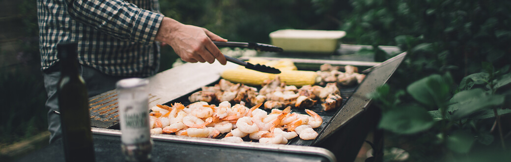 Healthy Grilling Tips. A person grilling.