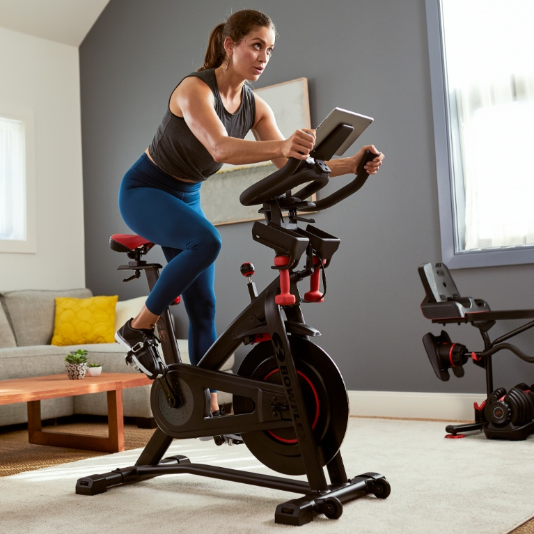 A woman working out on a Bowflex C6.