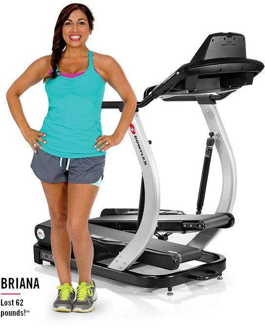 Briana lost 62 pounds. Briana is standing next to a TreadClimber.