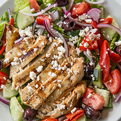 Greek marinated chicken over a greek salad.