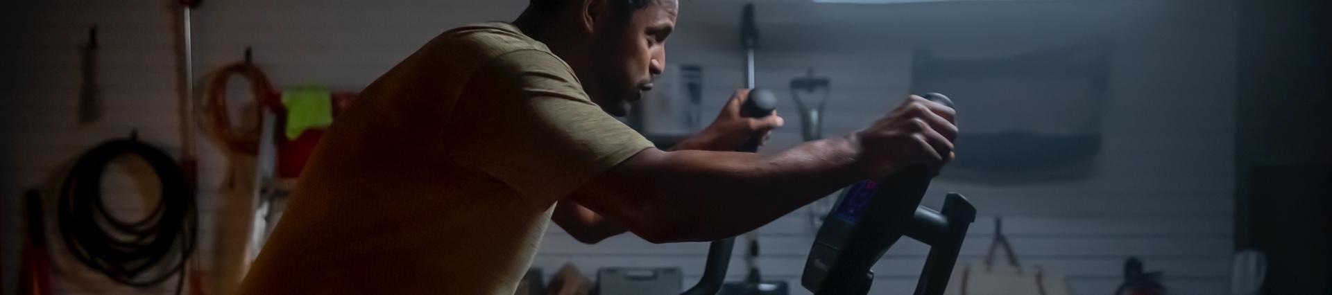 athletic man using a Bowflex Max Trainer