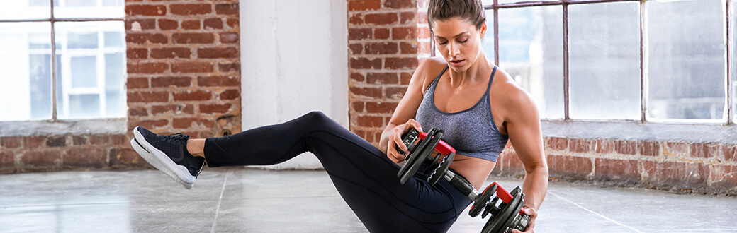 A woman performing a Tabata HIIT workout.