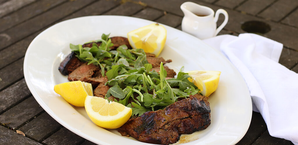 flank steak with arugula and lemon