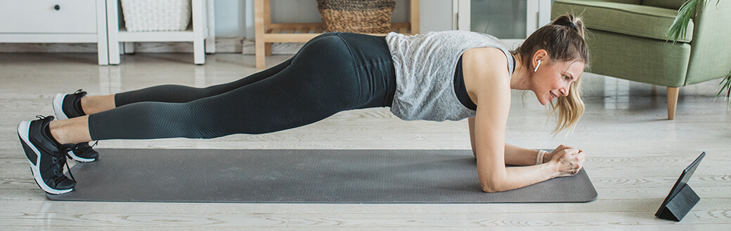 A woman performing a plank.
