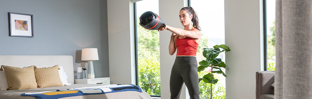 A woman performing a kettlebell workout.