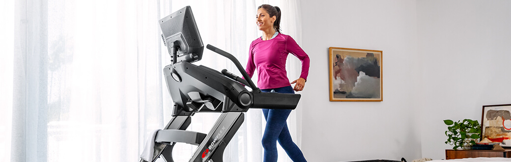 Woman using a Bowflex Treadmill.