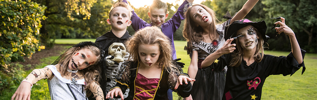 Several kids dressed in scary Halloween costumes.