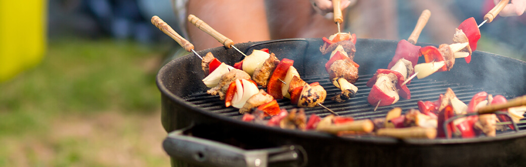 kabobs cooking on a grill.