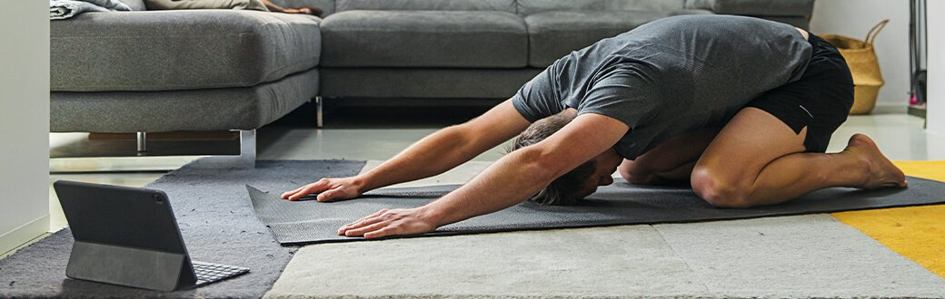 A man stretching indoors.
