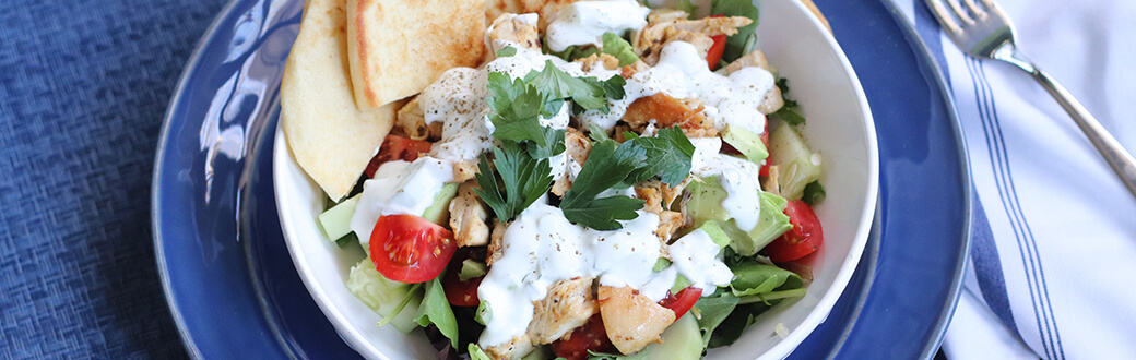 Chicken shawarma bowls with flat brand and homemade tzatziki sauce.