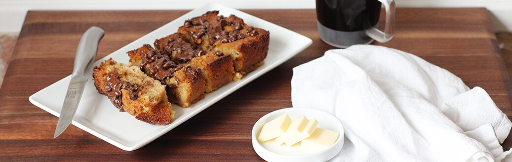 Sliced chocolate chip banana bread on a plate.