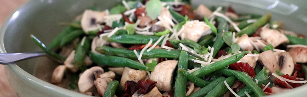 Green beans, mushrooms, bacon, and other ingredients in a bowl.