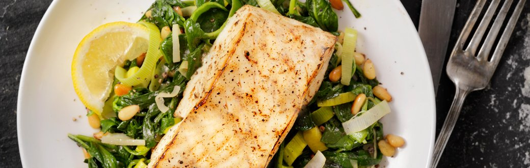 Oven roasted cod topped with lemon slices.