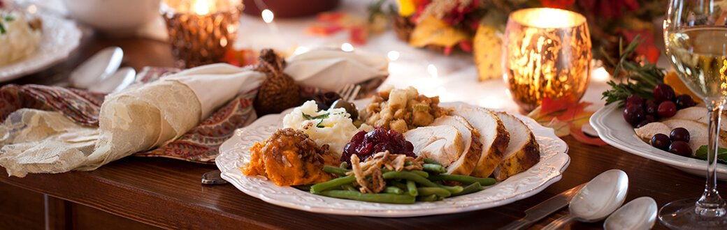 A dinner plate filled with Thanksgiving Day foods.