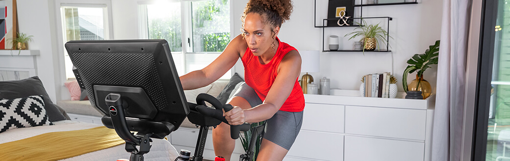 A person on a Bowflex VeloCore Bike.