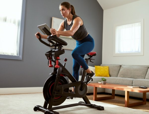 woman using a Bowflex C6 Bike in a house