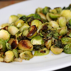 garlic roasted brussels sprouts served on a plate