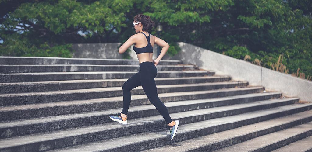 A person jogging up park steps