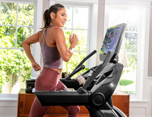 woman running on a Treadmill 22 in a sunny room