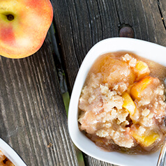 Grain-Free No-Sugar Added Peachy Crisp in a bowl.