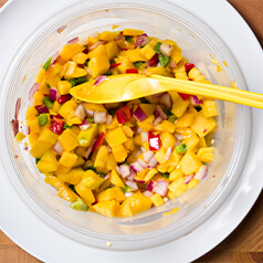 Mango cilantro salsa in a clear bowl.
