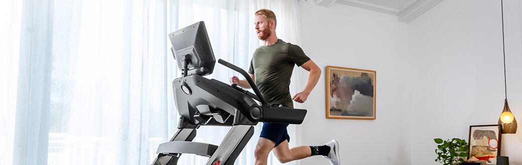 A man running on a Bowflex Treadmill 22.